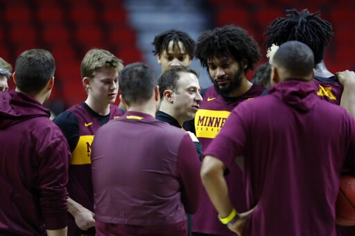 (AP Photo/Charlie Neibergall). Minnesota head coach Richard Pitino, center, talks to his team during practice at the NCAA men's college basketball tournament, Wednesday, March 20, 2019, in Des Moines, Iowa. Minnesota plays Louisville on Thursday.