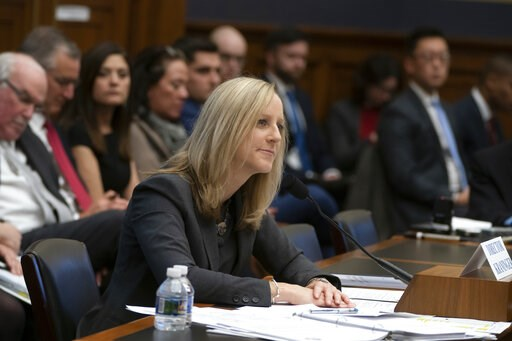 (AP Photo/J. Scott Applewhite, File). FILE- In this March 7, 2019, file photo Kathy Kraninger, director of the Consumer Financial Protection Bureau, takes questions from the House Financial Services Committee's biannual review of the CFPB, on Capitol H...