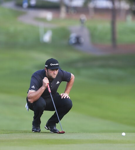 (Dirk Shadd/Tampa Bay Times via AP). Jon Rahm lines up a putt on the first hole during the first round of the Valspar Championship golf tournament in Palm Harbor, Fla., Thursday, March 21, 2019.
