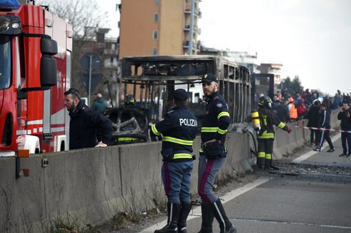 (Daniele Bennati/ANSA via AP). Firefighters and police officers stand by the gutted remains of a bus in San Donato Milanese, near Milan, Italy, March 21, 2019. Italian authorities say a bus driver transporting schoolchildren stopped his vehicle on a pr...