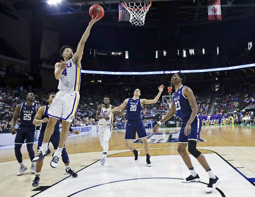 (AP Photo/John Raoux). LSU's Skylar Mays (4) goes up for a shot over Yale 's Paul Atkinson (20) and Jordan Bruner (23) during the first half of a first round men's college basketball game in the NCAA Tournament in Jacksonville, Fla., Thursday, March 21...