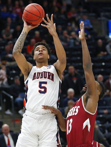 (AP Photo/Rick Bowmer). Auburn Tigers forward Chuma Okeke (5) shoots as New Mexico State forward C.J. Bobbitt (13) defends in the first half during a first round men's college basketball game in the NCAA Tournament, Thursday, March 21, 2019, in Salt La...
