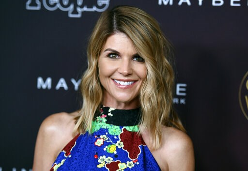 """(Photo by Richard Shotwell/Invision/AP, File). FILE - In this Oct. 4, 2017 file photo, actress Lori Loughlin arrives at the 5th annual People Magazine """"Ones To Watch"""" party in Los Angeles. The FBI says Loughlin has been taken into custody in connection..."""
