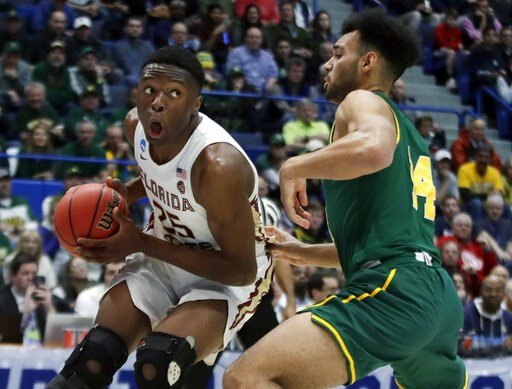 (AP Photo/Elise Amendola). Florida State's Mfiondu Kabengele (25) looks for room to drive against Vermont's Isaiah Moll (14) during the first half of a first round men's college basketball game in the NCAA Tournament, Thursday, March 21, 2019, in Hartf...