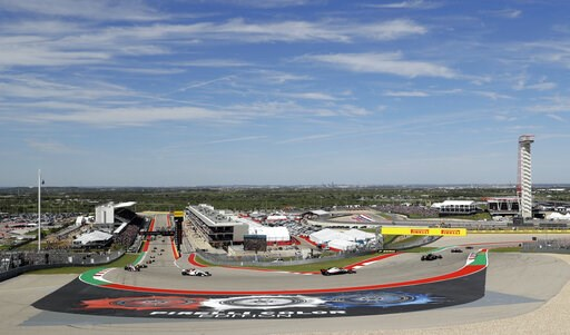 (AP Photo/Eric Gay, File). FILE - In this Oct. 21, 2018, file photo, drivers round a turn the opening lap out of turn one during the Formula One U.S. Grand Prix auto race at the Circuit of the Americas in Austin, Texas. After years of hosting the top E...