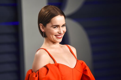 (Photo by Evan Agostini/Invision/AP, File). FILE - This Feb. 24, 2019 file photo, Emilia Clarke arrives at the Vanity Fair Oscar Party in Beverly Hills, Calif. Clarke has revealed she's had two life-threatening aneurysms, and two brain surgeries, since...
