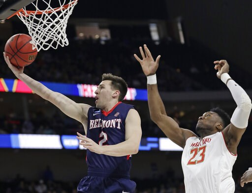 (AP Photo/John Raoux). Belmont guard Grayson Murphy (2) gets off a shot ahead of Maryland 's Bruno Fernando (23) during the first half of a first round men's college basketball game in the NCAA Tournament in Jacksonville, Fla., Thursday, March 21, 2019.