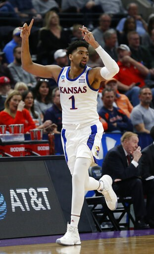 (AP Photo/Rick Bowmer). Kansas forward Dedric Lawson (1) celebrates after scoring a three-point basket against Northeastern in the first half during a first round men's college basketball game in the NCAA Tournament, Thursday, March 21, 2019, in Salt L...