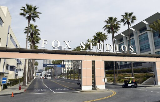 (AP Photo/Chris Pizzello). The exterior of Fox Studios is pictured, Tuesday, March 19, 2019, in Los Angeles. Disney's $71.3 billion acquisition of Fox's entertainment assets is set to close around 12 a.m. EDT on Wednesday.