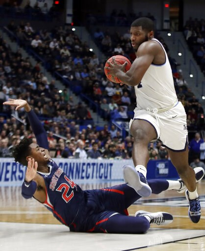 (AP Photo/Elise Amendola). Villanova's Eric Paschall, right, drives against St. Mary's Malik Fitts (24) during the second half of a first round men's college basketball game in the NCAA Tournament, Thursday, March 21, 2019, in Hartford, Conn.