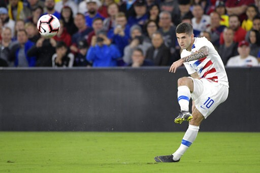 (AP Photo/Phelan M. Ebenhack). United States midfielder Christian Pulisic (10) passes the ball during the first half of an international friendly soccer match against Ecuador, Thursday, March 21, 2019, in Orlando, Fla.