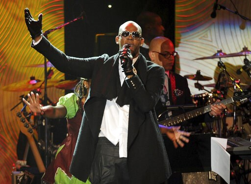 (Photo by Frank Micelotta/Invision/AP, File). FILE - In this Jan. 25, 2014 file photo, recording artist R. Kelly performs at The 56th Annual Grammy Awards Salute to Industry Icons with Clive Davis in Beverly Hills, Calif. A Chicago judge is expected to...