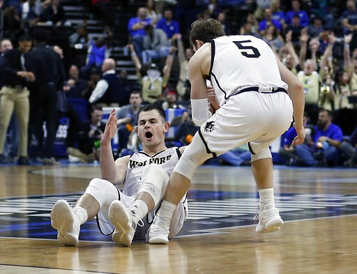 (AP Photo/Stephen B. Morton). Wofford's Fletcher Magee, left, reacts after drawing a foul on a 3-point shot as Storm Murphy (5) helps him up during the first half against Seton Hall in a first-round game in the NCAA men's college basketball tournament ...