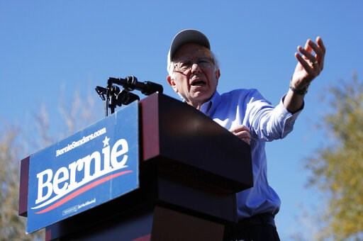 (AP Photo/John Locher). FILE - In this March 16, 2019 photo, 2020 Democratic presidential candidate Sen. Bernie Sanders speaks at a rally in Henderson, Nev.  The Vermont senator was an insurgent outsider three years ago in a head-to-head race against H...