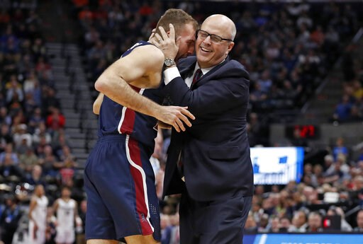 (AP Photo/Jeff Swinger). Fairleigh Dickinson forward Nadi Beciri, left, is embraced by coach Greg Herenda after a second-half shot against Gonzaga in a first-round game in the NCAA men's college basketball tournament Thursday, March 21, 2019, in Salt L...