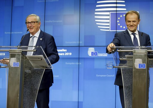 (AP Photo/Olivier Matthys). European Council President Donald Tusk, right, and European Commission President Jean-Claude Juncker participate in a media conference at an EU summit in Brussels, Thursday, March 21, 2019. Worn down by three years of indeci...