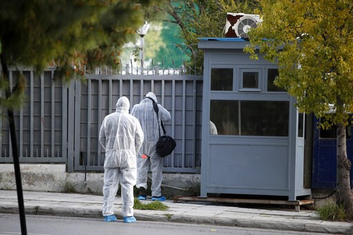 (AP Photo/Thanassis Stavakis). Forensic experts search the area outside the Russian consulate in Athens, Friday, March 22, 2019. Police say a bomb disposal squad has been sent to the Russian consulate in Athens after cameras showed a suspicious object ...