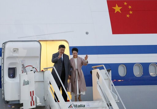 (AP Photo/Andrew Medichini). Chinese President Xi Jinping and his wife Peng Liyuan arrive at Rome's Leonardo Da Vinci airport in Fiumicino, Italy, Thursday, March 21, 2019. Jinping is in Italy to sign a memorandum of understanding to make Italy the fir...