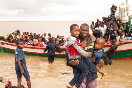 (Photo -Denis Onyodi - Red Cross Red Crescent Climate Centre via AP). In this photo supplied by the Red Cross Red Crescent Climate Centre survivors of Cyclone Idai arrive by rescue boat in Beira, Mozambique, Thursday, March 21, 2019. The confirmed deat...