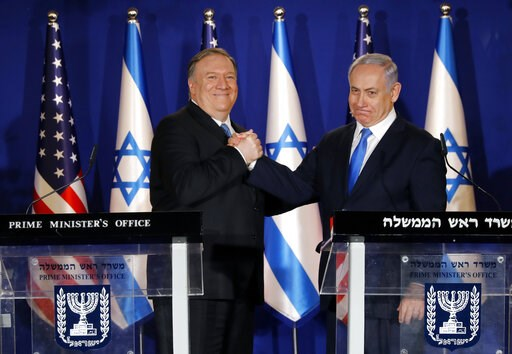 (Amir Cohen/Pool via AP). U.S. Secretary of State Mike Pompeo, left, shakes hands with Israeli Prime Minister Benjamin Netanyahu, during their visit to Netanyahu's official residence in Jerusalem, Thursday March 21, 2019. Netanyahu has praised U.S. Pre...