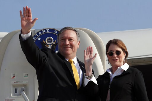 (Jim Young/Pool Photo via AP). U.S. Secretary of State Mike Pompeo and his wife Susan wave before boarding their airplane to Beirut at Ben Gurion airport near Lod, Israel, Friday, March 22, 2019.