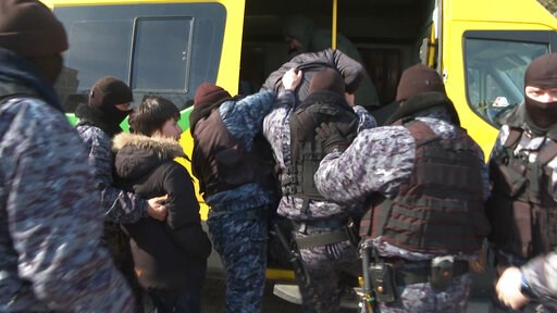 (Serhii Nuzhnenko/Radio Free Europe/Radio Liberty via AP). In this video grab from Radio Free Europe/Radio Liberty stream video, taken on Thursday, March 21, 2019, police officers detain a small group of people who were protesting against the renaming ...