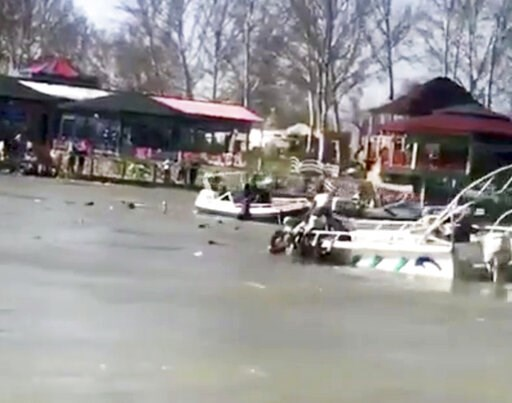 (Mohammed Issam via AP). This image taken from video provided by Mohammed Issam shows boats trying to rescue people in the Tigris River after a overloaded ferry sank on Thursday, March 21, 2019 near Mosul, Iraq. Col. Hussam Khalil, head of the Civil De...