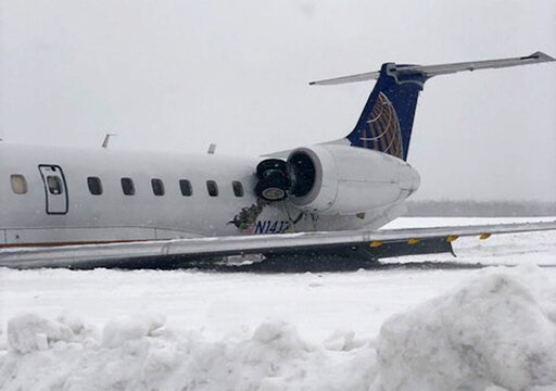 (Cassie Daigle via AP). A United Express regional jet that slid off a runway during a snow storm is seen where it came to a rest at Presque Isle International Airport on Monday, March 4, 2019, in Presque Isle, Maine. National Transportation Safety Boar...