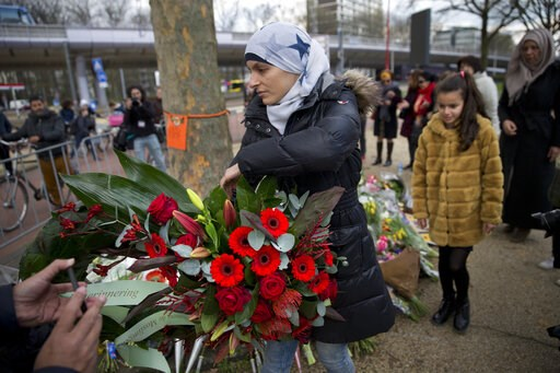 (AP Photo/Peter Dejong). Women representing Utrecht's Muslim community lay a wreath at a makeshift memorial for the victims of a shooting incident in a tram in Utrecht, Netherlands, Tuesday, March 19, 2019. A gunman killed three people and wounded othe...