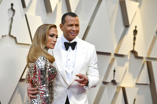 (Photo by Jordan Strauss/Invision/AP, File). FILe - In this Feb. 24, 2019 file photo, Jennifer Lopez, left, and Alex Rodriguez arrive at the Oscars  at the Dolby Theatre in Los Angeles.  Barack Obama is feeling the love about the engagement of Lopez an...