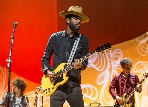"""(Photo by Amy Harris/Invision/AP, File). FILE - This Nov. 5, 2017 file photo shows Gary Clark Jr. performing at the Summit LA17 in Los Angeles. Clark confronts racism with his new album """"This Land."""""""