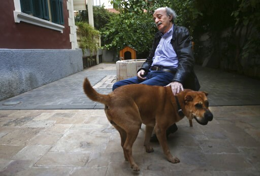 (AP Photo/Hussein Malla, File). FILE -- In this May 28, 2014 file photo, Walid Jumblatt, the political leader of Lebanon's minority Druse sect, pets his dog Oscar as he speaks during an interview with The Associated Press at his garden house in Beirut,...