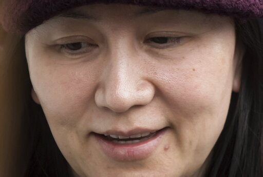 (Darryl Dyck/The Canadian Press via AP). FILE - In this March 6, 2019 file photo, Huawei chief financial officer Meng Wanzhou arrives back at her home after a court appearance in Vancouver.  China has stopped all new purchases of Canadian canola seeds ...