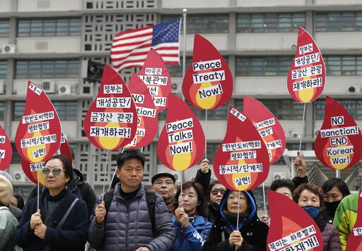 (AP Photo/Lee Jin-man). Protesters hold signs during a rally demanding the denuclearization of the Korean Peninsula and peace treaty near the U.S. embassy in Seoul, South Korea, Thursday, March 21, 2019. The Korean Peninsula remains in a technical stat...