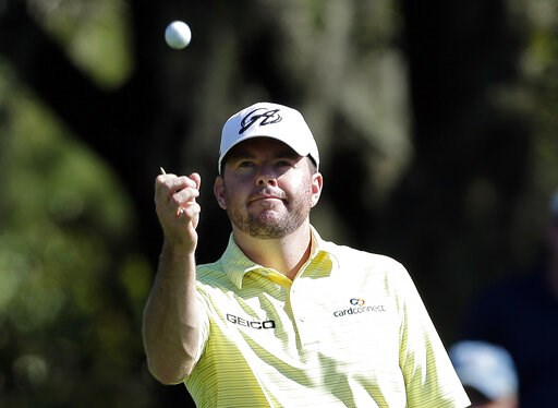(AP Photo/Chris O'Meara, File). FILE - In this March 15, 2014, file photo, Robert Garrigus looks at his golf ball during the third round of the Valspar Championship golf tournament at Innisbrook in Palm Harbor, Fla. Garrigus has become the first player...