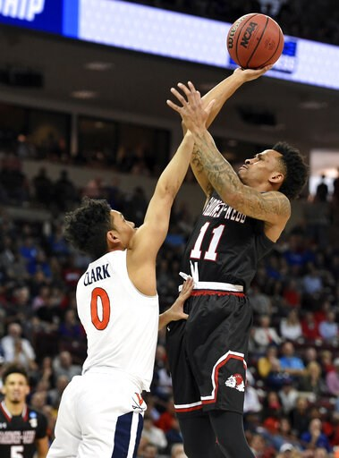 (AP Photo/Richard Shiro). Gardner-Webb's David Efianayi (11) shoots over Virginia's Kihei Clark (0) during a first-round game in the NCAA men's college basketball tournament in Columbia, S.C., Friday, March 22, 2019.