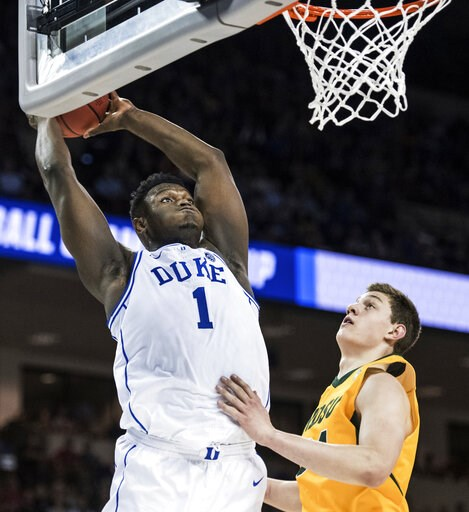 (AP Photo/Sean Rayford). Duke forward Zion Williamson (1) goes up for a dunk against North Dakota State forward Rocky Kreuser (34) during the first half of a first-round game in the NCAA men's college basketball tournament Friday, March 22, 2019, in Co...
