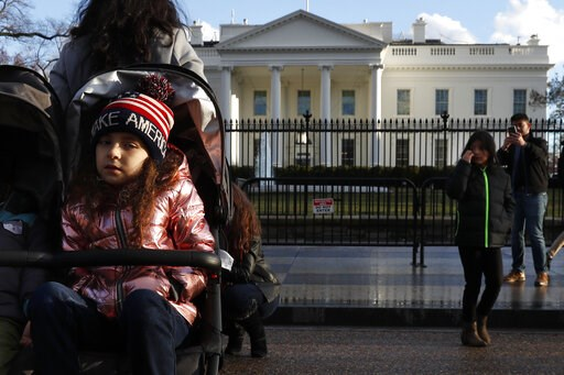 (AP Photo/Jacquelyn Martin). Tourists visit the White House with her family, Friday March 22, 2019, in Washington, as news breaks that special counsel Robert Mueller has concluded his investigation into Russian election interference and possible coordi...