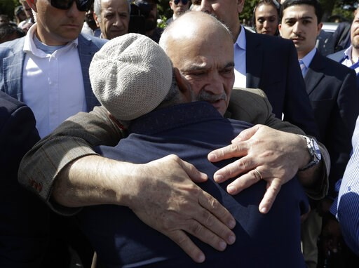 (AP Photo/Mark Baker). His Royal Highness Prince El Hassan bin Talal Hashemite, of the Kingdom of Jordan, embraces a worshipper outside the Al Noor mosque in Christchurch, New Zealand, Saturday, March 23, 2019. The mosque reopened today following the M...