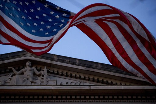 (AP Photo/Andrew Harnik). An American flag flies outside the Department of Justice in Washington, Friday, March 22, 2019. Special counsel Robert Mueller has concluded his investigation into Russian election interference and possible coordination with a...