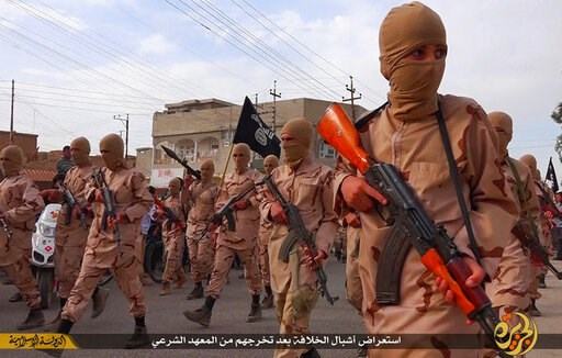 "(Militant website via AP, File). FILE - In this file photo released on April 25, 2015, by a militant website, which has been verified and is consistent with other AP reporting, young boys known as the ""caliphate cubs"" hold their rifles as they parade a..."
