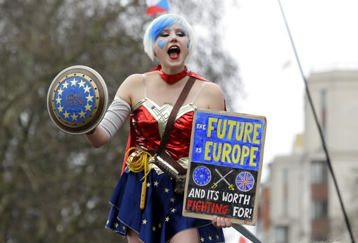(AP Photo/Kirsty Wigglesworth). A demonstrator holds a holds a poster during a Peoples Vote anti-Brexit march in London, Saturday, March 23, 2019. The march, organized by the People's Vote campaign is calling for a final vote on any proposed Brexit dea...