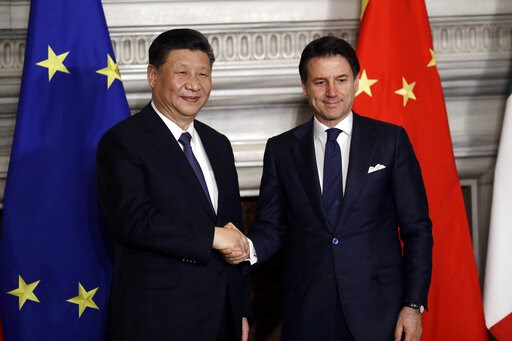 (AP Photo/Andrew Medichini). Chinese President Xi Jinping, left, and Italian Premier Giuseppe Conte shake their hands at the end of the signing ceremony of a memorandum of understanding at Rome's Villa Madama, Saturday, March 23, 2019. Jinping is in It...