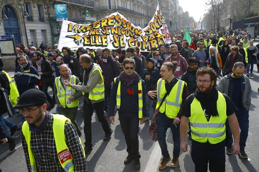 (AP Photo/Michel Euler). Protesters gather during a rally in Paris, Saturday, March 23, 2019. Yellow vest demonstrators gathered in Paris and other French cities for a 19th round of demonstrations as authorities issued bans on protests in certain areas...