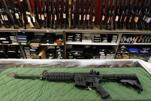 (AP Photo/Alex Brandon, File). FILE - In this Thursday, July 26, 2012 file photo, an AR-15 style rifle is displayed at the Firing-Line indoor range and gun shop, in Aurora, Colo. A new poll shows a majority of Americans favor stricter gun laws, and mos...