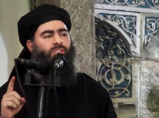 (Militant video via AP, File). FILE - This image made from video posted on a militant website July 5, 2014, purports to show the leader of the Islamic State group, Abu Bakr al-Baghdadi, delivering a sermon at a mosque in Iraq during his first public ap...