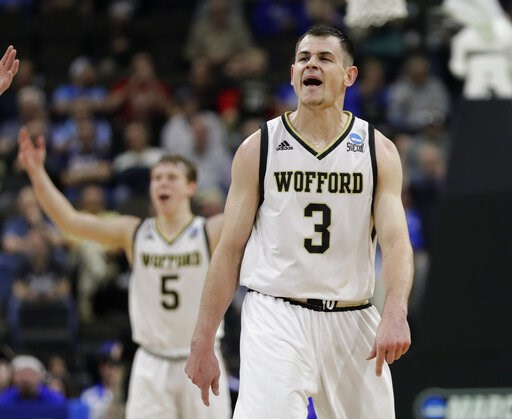 (AP Photo/John Raoux). Wofford's Fletcher Magee (3) celebrates a 3-point shot against Seton Hall with teammate Storm Murphy (5) during the second half of a first-round game in the NCAA men's college basketball tournament in Jacksonville, Fla., Thursday...