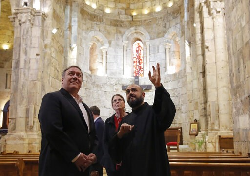 (Jim Young/Pool Photo via AP). U.S. Secretary of State Mike Pompeo and his wife Susan visit a church at Byblos, Lebanon, Saturday, March 23, 2019.
