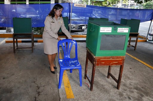 (AP Photo/Sakchai Lalit). A Thai officer adjusts a chair before the voting for the general election at a polling station in Bangkok, Thailand, Sunday, March 24, 2019. Thailand's first general election since the military seized power in a 2014 coup is s...