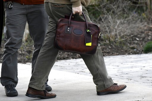 (AP Photo/Sait Serkan Gurbuz). Attorney General William Barr carries his briefcase as he arrives at his home in McLean, Va., on Saturday evening, March 23, 2019. Barr scoured special counsel Robert Mueller's confidential report on the Russia investigat...